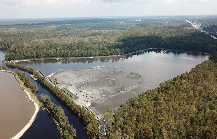 Aerial view of Grainger's Ash Pond 2, which being pumped with water to equalize pressure on the dikes from the rising waters of the Waccamaw River.