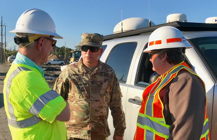 Santee Cooper Interim President and CEO Jim Brogdon discusses ash pond mitigation efforts with Army National Guard Major General Robert E. Livingston Jr. and S.C. Secretary of Transportation Christy Hall.