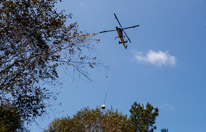 A heavy lift helicopter carries sandbags to ash pond 2 in an effort to shore up the banks of the Grainger ash ponds before river levels rise as a result of flooding caused by Hurricane Florence  Friday, Sept. 21, 2018 in Conway.