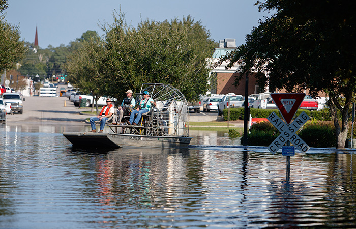 Water flows over the road at the Conway Marina as river levels rise as a result of flooding caused by Hurricane Florence Friday, Sept. 21, 2018 in Conway.