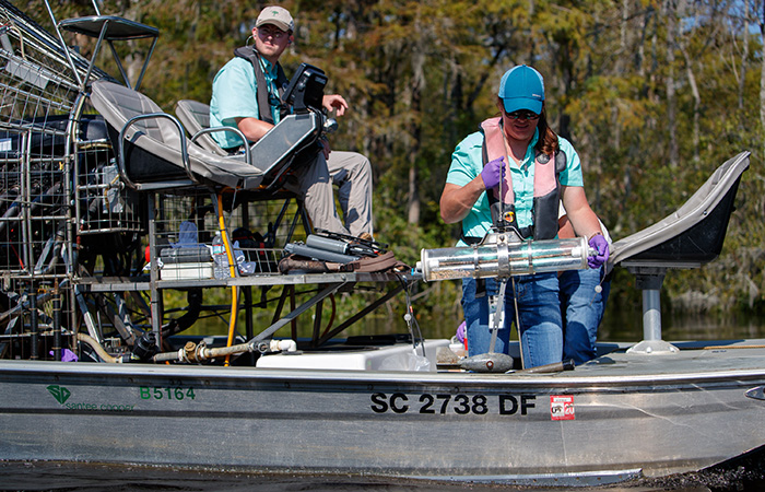 Crews with Biological Services check the water quality of the Waccamaw River for any signs of ash contamination Friday, Sept. 21, 2018 in Conway.