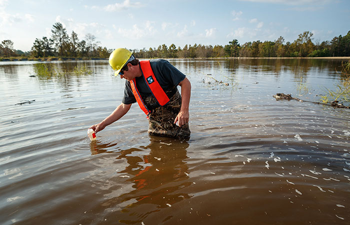 Water samples are taken in Grainger Ash Pond 1 as river water levels top the dike of the pond. Saturday, Sept. 22, 2018 in Conway.
