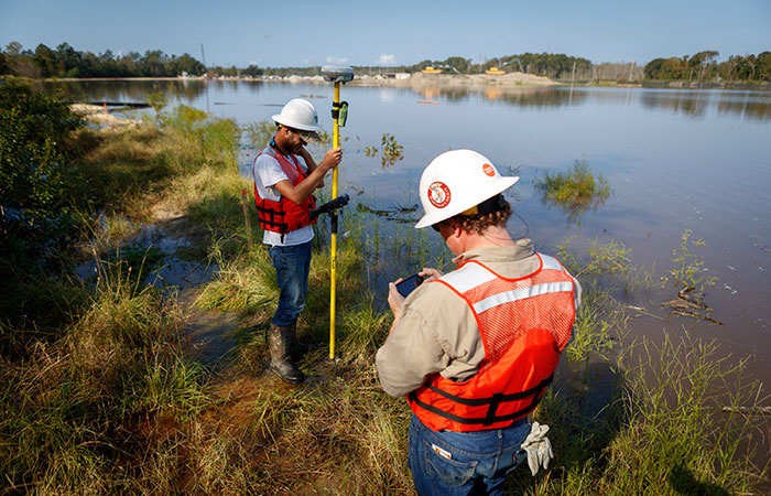 Crews monitor the banks of the Grainger Ash Pond 1 as the river levels overtop the dike of the pond. Saturday, Sept. 22, 2018 in Conway.