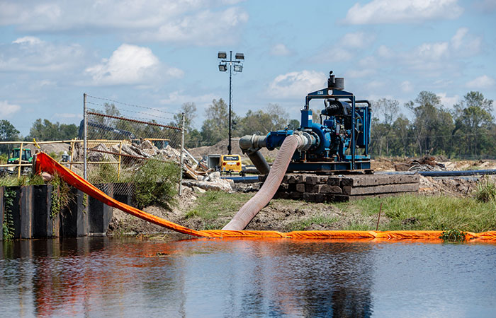 A series of dikes are put into place and water is pumped into the ash ponds to protect them from  rising river levels as a result of flooding caused by Hurricane Florence.