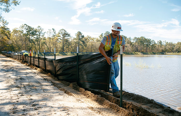 Crews with Palmetto Corp. work to protect the banks of the Grainger Ash Pond 2 with silt fencing before river levels rise as a result of flooding caused by Hurricane Florence.