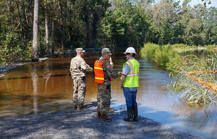 Santee Cooper crews work with the Army Corps of Engineers on the Grainger ash ponds before river levels rise as a result of flooding caused by Hurricane Florence.