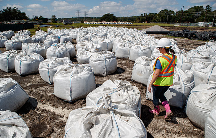 Bags containing 1.5 tons of rock sit ready to deploy by helicopter in the event of a river breach of the dikes surrounding the Grainger ash ponds.