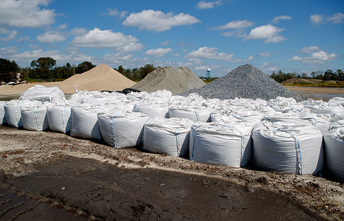 Sand bags sit ready to deploy in the event of a river breach of the dikes surrounding the Grainger ash ponds before river levels rise as a result of flooding caused by Hurricane Florence.