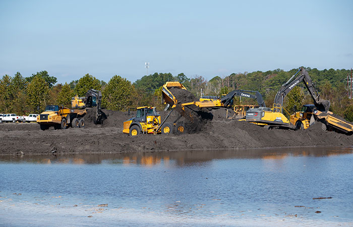 Coal ash in Pond 2 is piled to minimize any leakage as crews work to fortify the banks of the Grainger ash ponds before river levels rise as a result of flooding caused by Hurricane Florence.