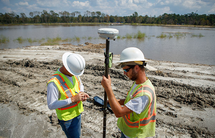 Crews check elevations as they shore up the banks of the Grainger ash ponds before the Waccamaw River reaches projected record heights.