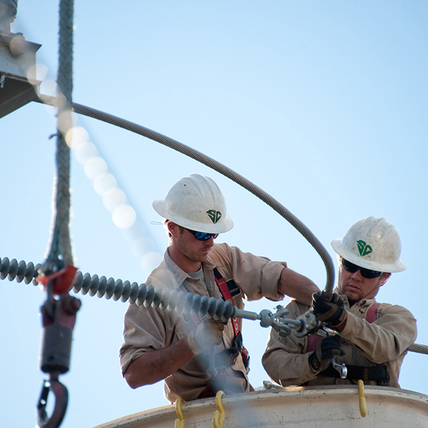 People working on utility cable