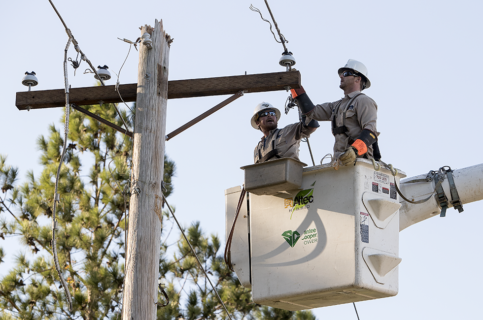 Employees Restoring Power to Customers